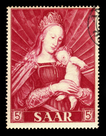 younger: Germany, Saarland - CIRCA 1954: a stamp printed in the Saar, Germany shows painting by Hans Holbein the Younger: Madonna of the town major of Basel, circa 1954