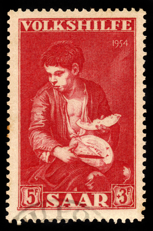 bartolome: Germany, Saarland - CIRCA 1954: a stamp printed in the Saar, Germany shows painting fragment Bartolome Esteban Murillo: boys eating grapes and melon, circa 1954 Editorial