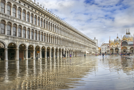 procuratie: St. Marks Square (Piazza San Marco) during flood (acqua alta) in Venice, Italy