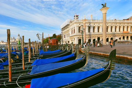 traditional venetian gondolas moored on the Grand Canal near San Marco Square in Venice, Italy