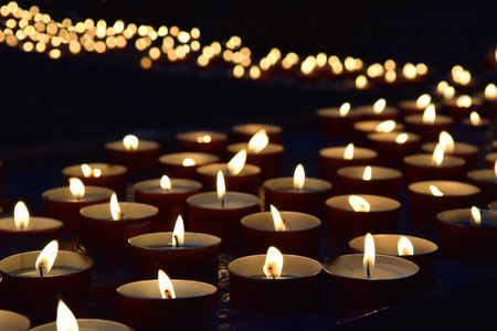 burning memorial candles on the dark background