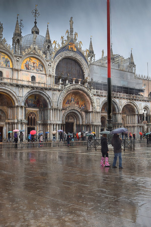st marks square: St. Marks Square (Piazza San Marco) during rain in Venice, Italy