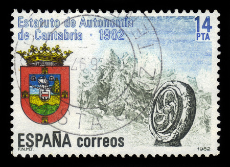 autonomia: SPAIN, CIRCA 1982: stamp printed in Spain , shows coat of arms autonomy Cantabria on the background of mountains, circa 1982 Editorial