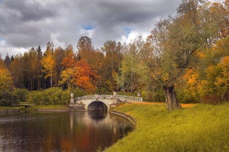 autumn landscape in Pavlovsk park, garden and park reserve in neighborhood of Saint Petersburg, Russia