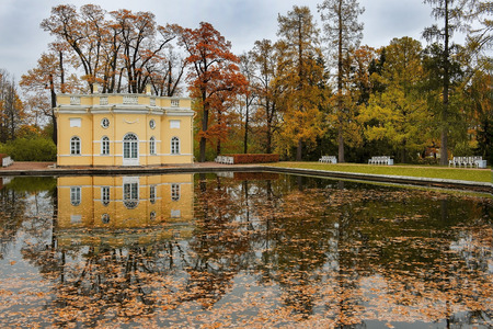 The Upper Bathhouse Pavilion reflected in a mirror pond in Catherine Park. The Tsarskoye Selo (Pushkin) is State Museum-Preserve and located near Saint-Petersburg, Russia