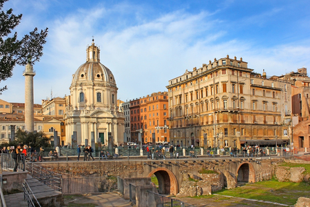 tourists visiting Trajan Forum and Santa Maria di Loreto church in Rome, Italy Stock Photo