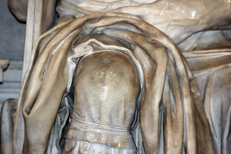 knee with a scar from the sculptor tool, detail of famous sculpture - Moses by Michelangelo, located in San Pietro in Vincoli basilica, Rome,Italy