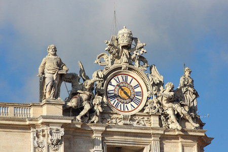 Vatican: January 02, 2017 : one of the giant clocks on the facade Saint Peter basilica on january 02, 2017 Vatican. two clocks were added on both sides of the  facade in 1786-1790 by Giuseppe Valadier