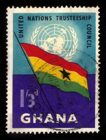 un used: Ghana - circa 1959: A stamp printed in Ghana shows Ghana flag and UN emblem, United Nations Trusteeship Council, circa 1959