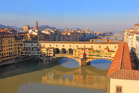 tile-roofed Vasari corridor running from the Uffizi across the Ponte Vecchio over the Arno River on its way to Palazzo Pitti in Florence, Tuscany, Italy