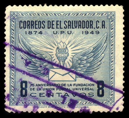 upu: EL SALVADOR - CIRCA 1949: A stamp printed in El Salvador shows wings, torch and letter, U.P.U. (Universal Postal Union), 75th Anniversary, circa 1949 Editorial