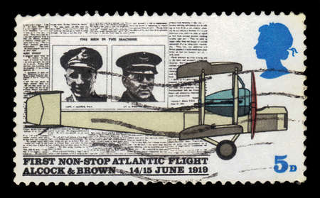 vickers: UNITED KINGDOM - CIRCA 1970: A stamp printed in UK shows newspaper Daily Mail and aeroplane Vickers Vimy, 50 years since the first non stop Atlantic flight, Alcock and Brown, 1415 June 1919, circa 1970