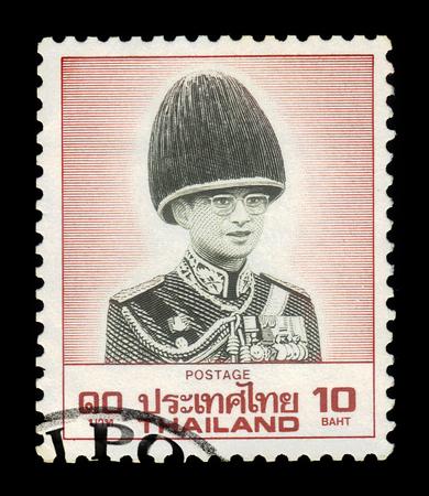 Thailand - CIRCA 1988: A stamp printed in Thailand shows portrait King Bhumibol Adulyadej in military uniform, King of Thailand ( King Rama IX ), circa 1988