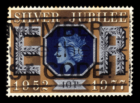 UNITED KINGDOM - CIRCA 1977: A stamp printed in Great Britain shows face profile of Queen Elizabeth II, series Silver Jubilee of Queen Elizabeth II, circa 1977 Editorial