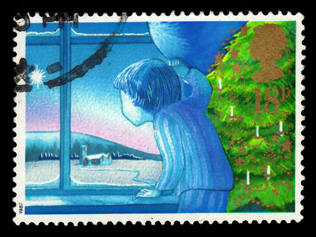 UNITED KINGDOM - CIRCA 1987: A stamp printed in Great Britain shows waiting for Father Christmas, series Christmas 1987 - Angels, circa 1987