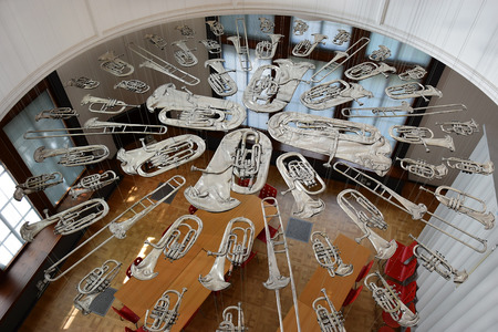 LONDON, ENGLAND - May 24,2017: flattened brass music instruments, sculpture Breathless, installation by Cornelia Parker Victoria and Albert Museum, London, UK Editorial