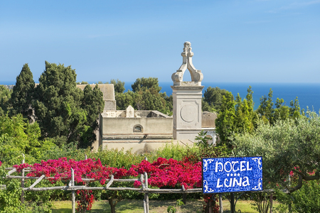 di: CAPRI, ITALY - MAY 21, 2017: view of Certosa di San Giacomo, Carthusian monastery and signpost to the entrance to the hotel Luna, Bay of Naples in Southern Italy