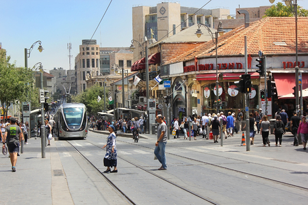 jaffa: JERUSALEM, ISRAEL - June 15, 2017: cityscape with light rail  at the Jaffa Road, one of the most famous streets in the heart of the city of Jerusalem, Israel Editorial