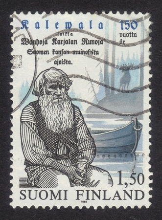 postmark: FINLAND - CIRCA 1985: a stamp printed in Finland shows portrait Petri Shemeikka (1821-1915) karelian poet singer, series centenary of the national epic Kalevala, circa 1985 Editorial