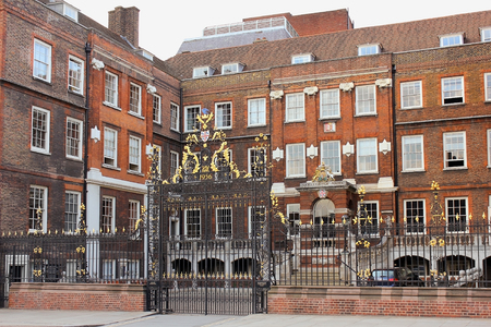 LONDON, ENGLAND - May 24,2017: decorative forged gates and main facade of the College of Arms, also known as the College of Heralds in London, UK Editorial