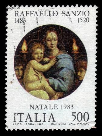 ITALIA - CIRCA 1983: A stamp printed in Italia shows Madonna and Child, painting by italian artist Raphael Sanzio, christmas, circa 1983