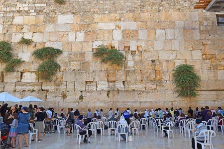 JERUSALEM, ISRAEL - June 15, 2017: religious jews, praying at the Wailing Wall ( Western Wall or Kotel ), womens sector, Old City of Jerusalem, Israel