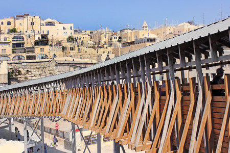JERUSALEM, ISRAEL - June 15, 2017: Mughrabi Bridge, a wooden bridge connecting the Wailing Wall area with the Mughrabi Gate of the Temple Mount in Jerusalem, Israel