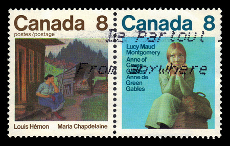 montgomery: CANADA - CIRCA 1975: A stamp printed in Canada shows illustrations for books: Anne of Green Gables by Lucy Maud Montgomery and Maria Chapdelaine by Louis Hemon, series canadian writers, circa 1975