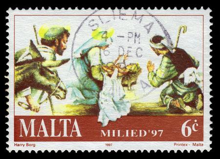 Malta - CIRCA 1997: A stamp printed in Malta shows Mary and baby Jesus, adoration of the Magi, Christmas (1997), circa 1997