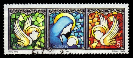 Malta - CIRCA 1996: A stamp printed in Malta shows Mary and baby Jesus, stained glass window, Christmas (1996), circa 1996 Editorial