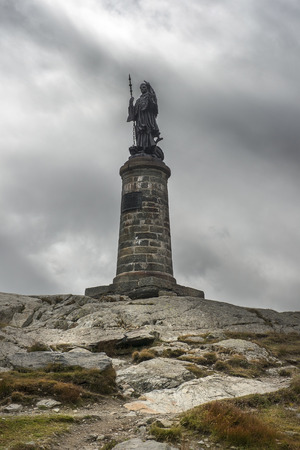 statue of Saint Bernard at the Great St Bernard Pass  Col du Grand-Saint-Bernard in the Swiss Alps, on the border between Italy and Switzerland Stock Photo