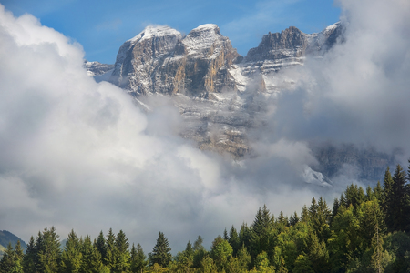 view of the steep mountain slopes covered with snow in the Swiss Alps