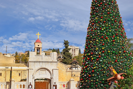 stock photo view of the greek orthodox church of the annunciation with christmas decorations and a christmas tree in nazareth israel - Greek Christmas Decorations