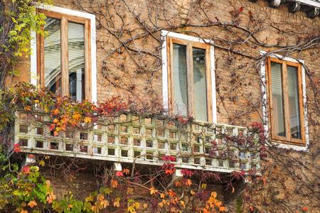 picturesque venetian windows with balconies, Venice, Italy