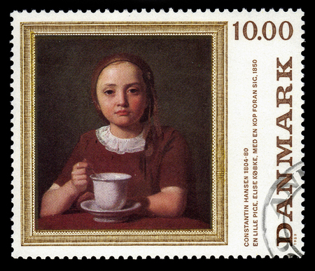 DENMARK - CIRCA 1989: A stamp printed in Denmark shows a painting a little girl Elise Kobke with cup by danish painter Constantin Hansen, circa 1989 報道画像