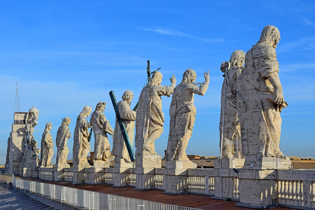 view of the buildings and statues of the apostles on the roof of St. Peters Basilica, Rome, Italy
