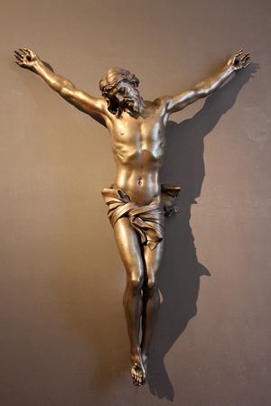 ROME, ITALY - January 25, 2018: bronze crucifix ( Cristo Crocifisso ), masterpiece by famous sculptor Gian Lorenzo Bernini Editorial