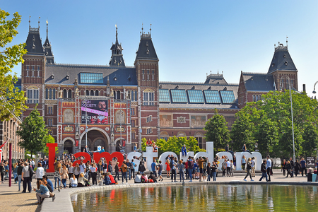 Amsterdam, the Netherlands - May 20, 2018: the square in front of the Rijksmuseum (State museum) and the letters I AMsterdam - one of known sights of the city Editorial