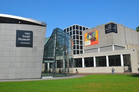 Amsterdam, the Netherlands - May 20, 2018: Van Gogh museum building complex at the Museum Square in Amsterdam, the Netherlands. Poster announcing the exhibition