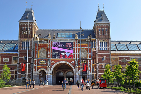 Amsterdam, the Netherlands - May 20, 2018: view of the main facade of the Rijksmuseum (State museum) in sunny day