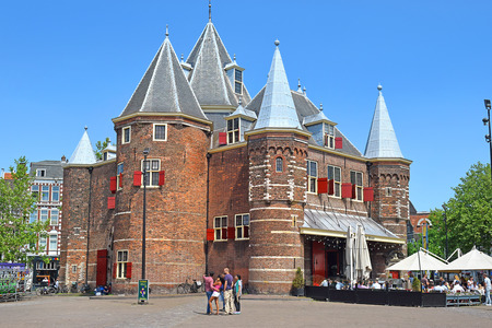 Amsterdam, North Holland, The Netherlands - May 21 2018: The Waag (weigh house) is a 15th-century building on Nieuwmarkt square in Amsterdam