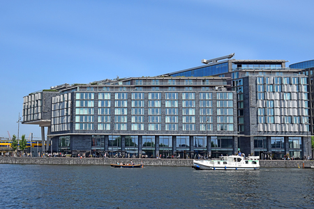 Amsterdam, North Holland, The Netherlands - May 20 2018: Exterior shot of Doubletree Hotel by Hilton near the central train station of Amsterdam, view from River IJ