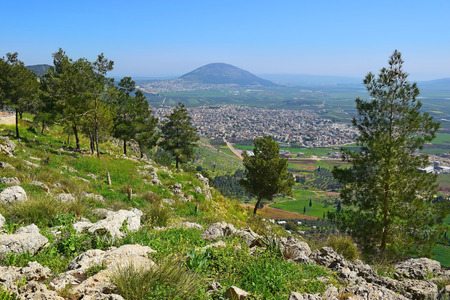 views of the Jezreel Valley and Mount Tabor from the heights of Mount Precipice, located just outside the southern edge of Nazareth, Lower Galilee, Israel Stock Photo