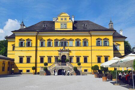 Salzburg, Austria - May 25, 2019 : main facade of Hellbrunn Palace (Schloss Hellbrunn), summer residence of the Archbishop of Salzburg