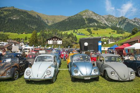 Château-d'Oex, Switzerland - August 31, 2019: annual international meeting of car lovers volkswagen beetle in small town Château-d'Oex,  canton of Vaud in Switzerland