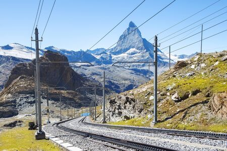 magnificent landscape in the Swiss Alps, in the foreground a railway, in the background a mountain Matterhorn