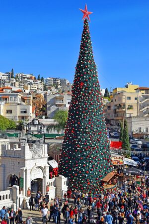 NAZARETH, ISRAEL - DECEMBER 21: People celebrate the Christmas, near the Greek Orthodox Church of the Annunciation in Nazareth, Israel, December 21, 2019