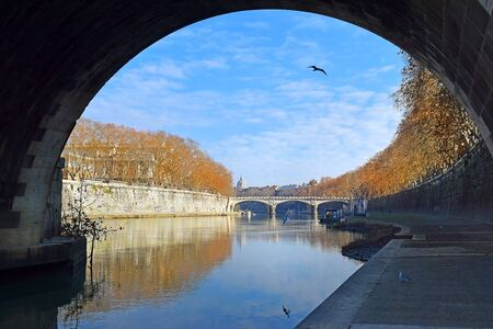 picturesque city landscape. view of the Tiber River and the embankment from under the bridge, Rome, Italy Archivio Fotografico