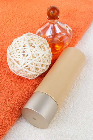 parfum: Body lotion with parfum on the terracotta towel