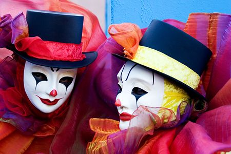 Two clowns in white carnivale mask, and top hats Stock Photo